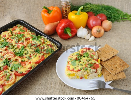 Rice casserole with vegetables Chicken fillet with tomato and cheese - stock photo