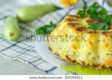 Rice casserole with zucchini and cheese omelet - stock photo