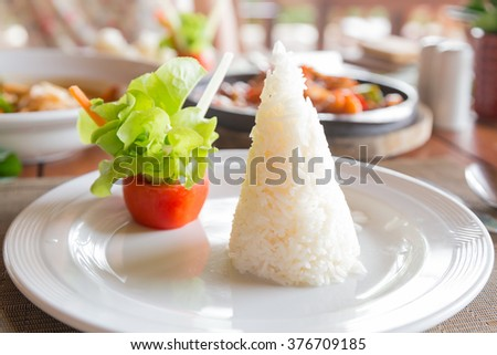 Rice cooked in a dish. On the table with the food in the restaurant for breakfast. - stock photo