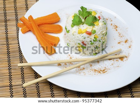 rice cooked with corn, vegetables and wooden sticks - stock photo