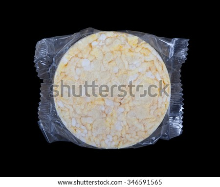 Rice cracker in plastic, isolated on black - stock photo