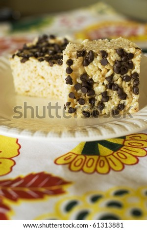 Rice Crispy Treat Squares with Mini Chocolate Chips on a White Plate - stock photo