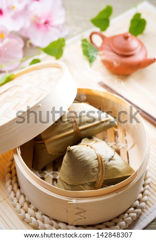 Rice dumpling or zongzi. Traditional steamed sticky  glutinous rice dumplings. Chinese food dim sum. Asian cuisine.