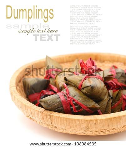 Rice dumplings on basket on white background - stock photo