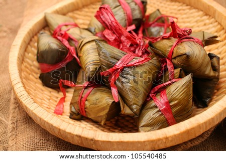Rice dumplings on basket with gunny background - stock photo