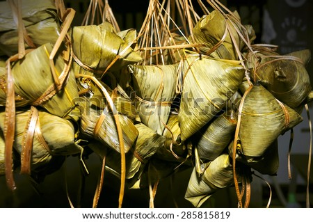 Rice dumplings with bamboo leaf, selective focus. - stock photo