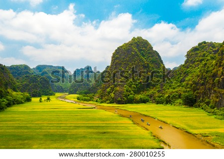 "Rice field and river ""Ngo Dong"" at TamCoc, Ninhbinh, Vietnam; famous for tourism at Vietnam. Ninhbinh city is located in the south than the capital Hanoi, Vietnam."
