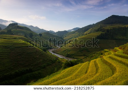 Rice fields on terraced in sunset at Mu Cang Chai, Yen Bai, Vietnam. Rice fields prepare the harvest at Northwest Vietnam - stock photo