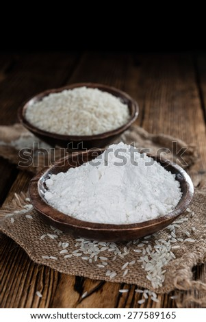 Rice Flour (close-up shot) on vintage wooden background