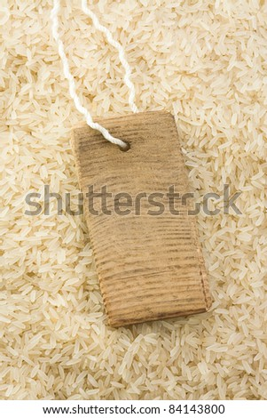 rice grain and price tag as background texture - stock photo