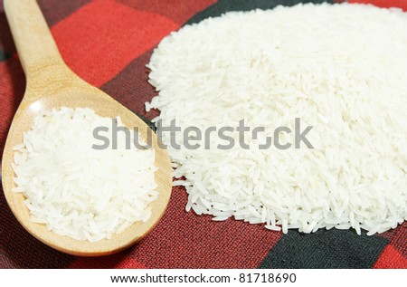 rice grain and wooden spoon
