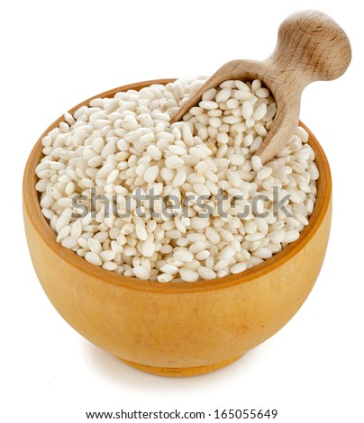 rice grain in wooden dish and scoop  isolated on white background - stock photo