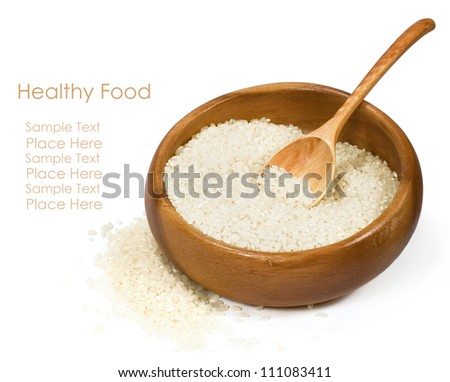 rice in a wooden bowl on a white background - stock photo