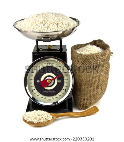 rice in the bag and on the scales isolated on white background - stock photo