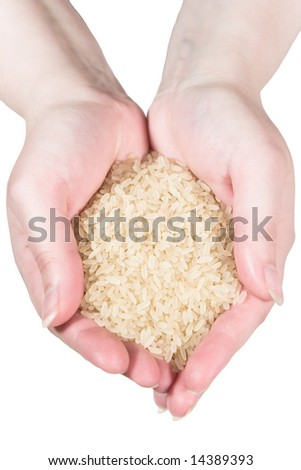 Rice in woman's hands (isolated on white) - stock photo