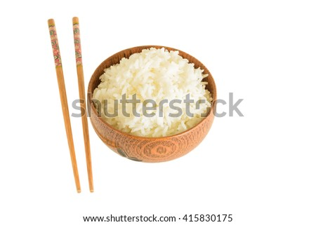 rice in wooden bowl and chopsticks on white background - stock photo