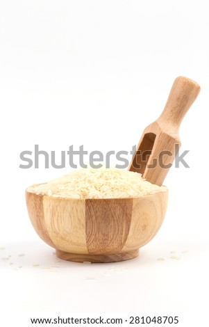 Rice in wooden bowl and spoon isolated on white background  - stock photo