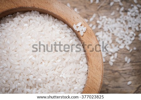 Rice in wooden bowl, close up