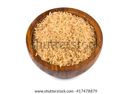 Rice in wooden bowl on white background - stock photo
