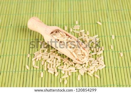 rice  in wooden  scoop on bamboo mat