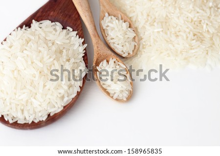 Rice in wooden spoons.