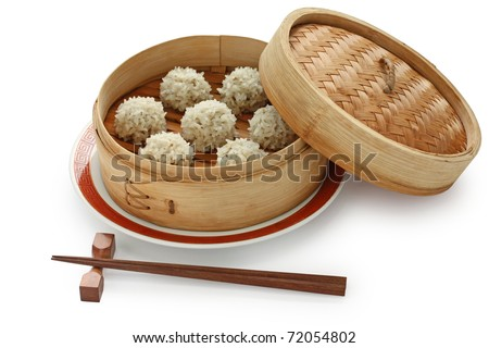 rice meatballs in the  bamboo steamer , chinese food - stock photo