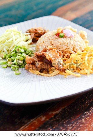 Rice Mixed with Shrimp paste in white dish on wooden table.