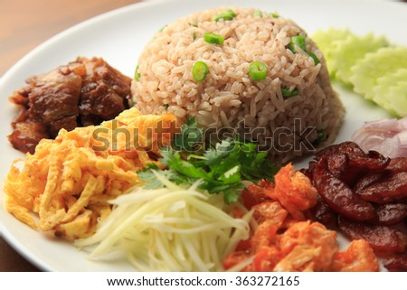 Rice Mixed with Shrimp paste on white dish with wooden background