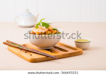 Rice noodles and shrimp in a white bowl. - stock photo