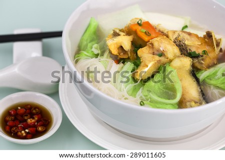 Rice noodles bee hoon noodles soup with fried fish - stock photo