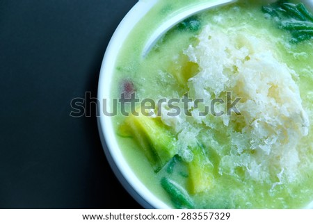 rice noodles made of rice eaten with coconut cream, thai dessert - stock photo
