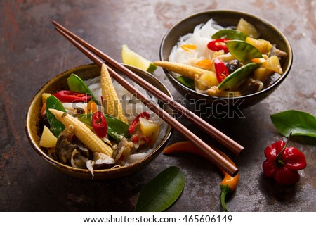 Rice noodles with vegetables and mushrooms, selective focus