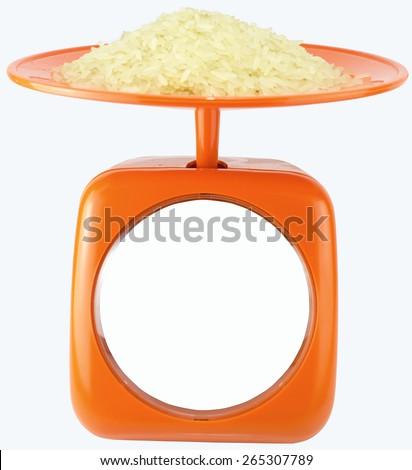 rice on a orange kilo scales with a white background - stock photo