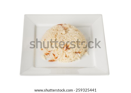 Rice on a Square Plate Isolated on a White Background.  - stock photo