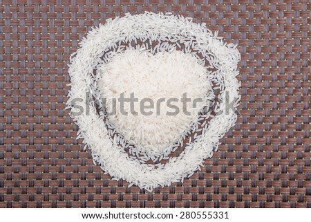 rice on bamboo weave - stock photo