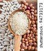 Rice on Wooden Spoon - stock photo