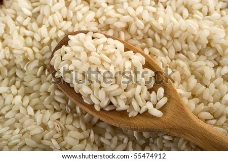 rice over the spoon - stock photo