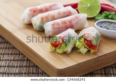 Rice paper rolls with prawns and dipping sauce - stock photo