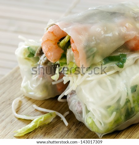 Rice paper rolls with shrimp and beanshoots. - stock photo