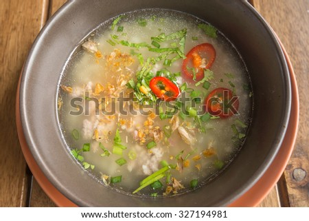 rice porridge with minced pork, thai breakfast.