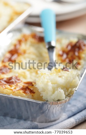 Rice pudding in the disposable aluminum baking pan - stock photo