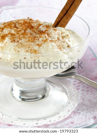 Rice pudding with grated cinnamon. - stock photo