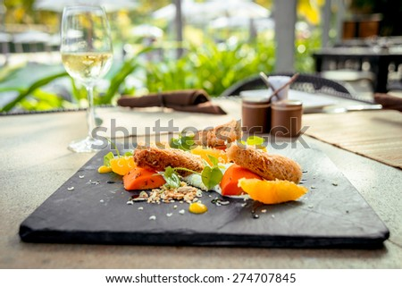 Rice rolls with vegetables on a white plate with a glass of wine. The Restaurant - stock photo