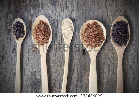 Rice seed,brown rice, keep healthy concept, brown background - stock photo