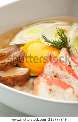 Rice Soup with Crab Meat and Egg Yolk - stock photo