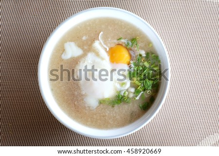 Rice soup with pork. Soup is a primarily liquid food, generally served warm, that is made by combining ingredients such as meat and vegetables with stock, juice, water, or another liquid.