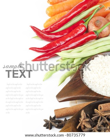 Rice, spices and fresh vegetables(red chili, green beans, carrot) With sample text - stock photo