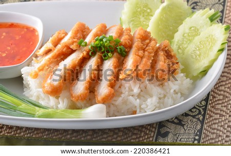 RICE STEAMED WITH CHICKEN SOUP or Khao Man Gai is a pretty common street food in Thailand but not so common in restaurants! - stock photo