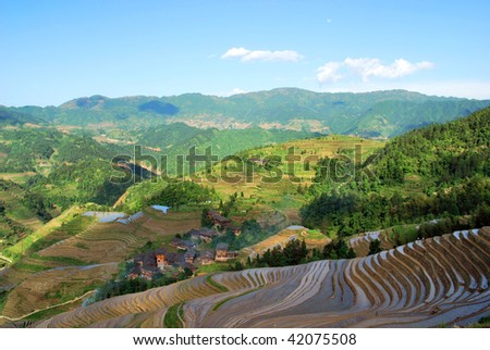 Rice terrace and village in the South China. Traditional lifestyle of thousand years. - stock photo
