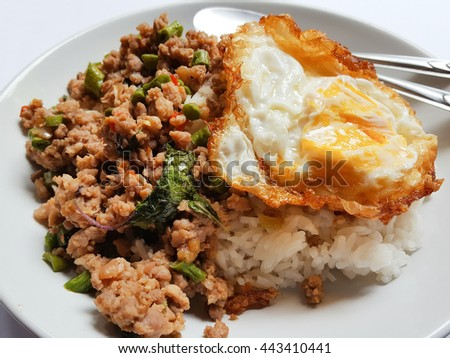 Rice topped with stir-fried minced pork and basil add fried egg
